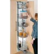 A woman reaches for a food item on a pantry shelf that has moved forward out of the cupboard