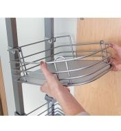 Adjusting the height of a shelf in the pantry unit
