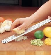 Using the Stainless Rasp to grate cheese, with lemon and lime rind already grated