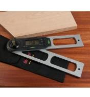 Starrett Digital Protractor lying on a table next to a piece of wood