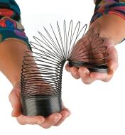 Playing with a Slinky using both hands