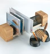 A Slinky built into a wooden frame to make a CD and envelope holder