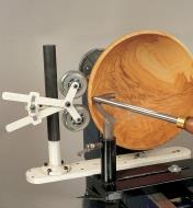 Bowl Steady positioned against a bowl on a lathe