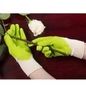 Wearing the Original Gripper Mud Gloves and holding a rose branch