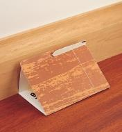 Spider Trap folded and placed against a baseboard