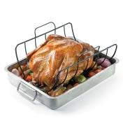 Roast chicken on a roasting rack sitting in a roasting pan with vegetables