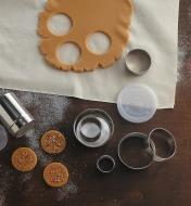 Stainless Steel Pastry Cutters being used to cut cookies from rolled-out dough