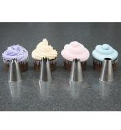 Large Icing Tips placed in front of frosted cupcakes as examples of the patterns they produce