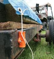 Speed Cinch Tie-Down Utility Cinch secures a tarp over a load on a trailer