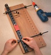 Clamping the rail onto a panel before drilling holes