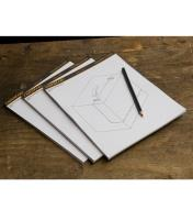 "Three 8 1/2"" x 11"" Drawing Pads fanned on a table"