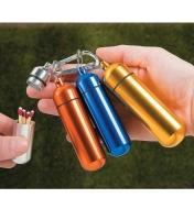 Set of 4 Utility Capsules, the silver one open and holding matches