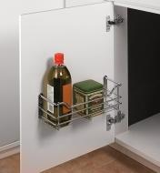 Utility Basket mounted inside a cupboard door, holding tea and cooking oil