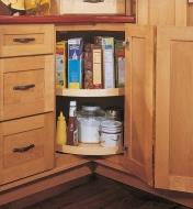 Example of kidney shelf installed in a corner kitchen cabinet