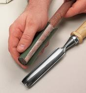 Micro-abrasive film being applied to a sharpening fid using transfer tape