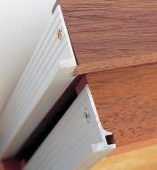 Close-ups of drawer backs made with Veritas Micro Drawer Slides/Sides shows notched method and routed method of construction