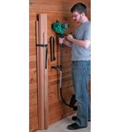 Hanging a string trimmer on a wall using a Wall-Mount Storage Straps & Brackets