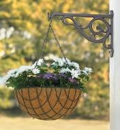 Bronze Victorian Wall Bracket holding a hanging basket on an outdoor post