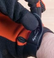 Adjusting the cuff on a work glove
