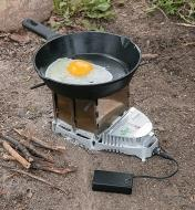 Cooking an egg in a frying pan on a VitalGrill Camp Stove