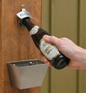 Opening a bottle of beer using the Wall-Mount Bottle Opener, with the Cap Catcher mounted below