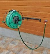Hose Reel holding a hose, mounted on a wall in the open position