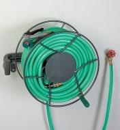 Hose Reel holding a hose, mounted on a wall in the closed position