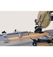 The Kreg Trak and Stop System being used with a miter saw to cut a piece of wood to exact length