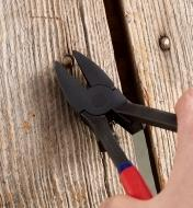 Removing a nail from a wall with the Nail Hunter