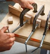Bessey heavy-duty C-clamps used to secure a bent lamination project to a curved form for glue-up