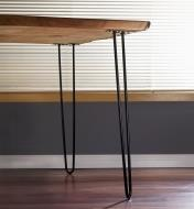 28-inch hairpin legs mounted on two corners of a live-edge coffee table