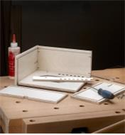 A Veritas router plane box shown partially assembled
