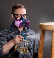 A man wearing the Elipse low-profile cartridge respirator