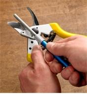 Sharpening the bypass pruner blade with diamond sharpening stick
