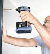 Driving a screw into a metal bracket with the Festool TID 18 Cordless Impact Screwdriver