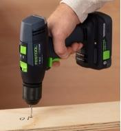 Drilling a hole into a piece of wood using the Festool T18+3 Easy cordless drill equipped with the 4.0 Ah battery