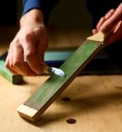 Stroping the edge of a chip carving knife on the Veritas Double-Sided Hand Strop charged with Veritas Honing Compound