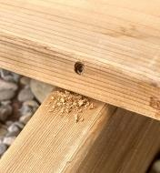 Close up of deck board showing how screw is concealed in the side