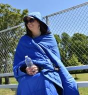 A Kubie multifunction blanket being worn as a poncho