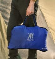 A Kubie multifunction blanket packed into its built-in handled carrying pouch