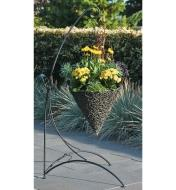 Basket of flowers hanging from a Shepherd's Hook Stand on a patio