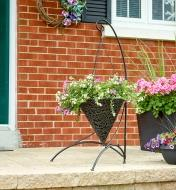 Cone-shaped basket planted with flowers