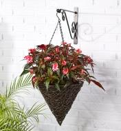 Cone-shaped basket hanging from a wall bracket