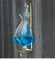 A filled Mariner Weather Glass hangs on a wall