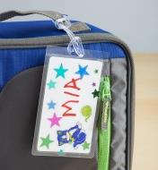 Decorated self-laminating ID tag attached to a lunchbag
