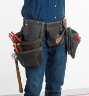 A man wearing the McGuire-Nicholas Standard Apron