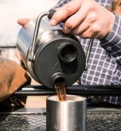 Pouring coffee into a mug from a 1/2 Gallon Yeti Jug