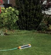 Hozelock Multi-Adjust Sprinkler/Mister watering a lawn with full spray setting