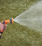 Hozelock Lightweight Sprayer spraying a cone pattern