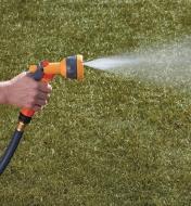 Hozelock Lightweight Sprayer spraying a fan pattern